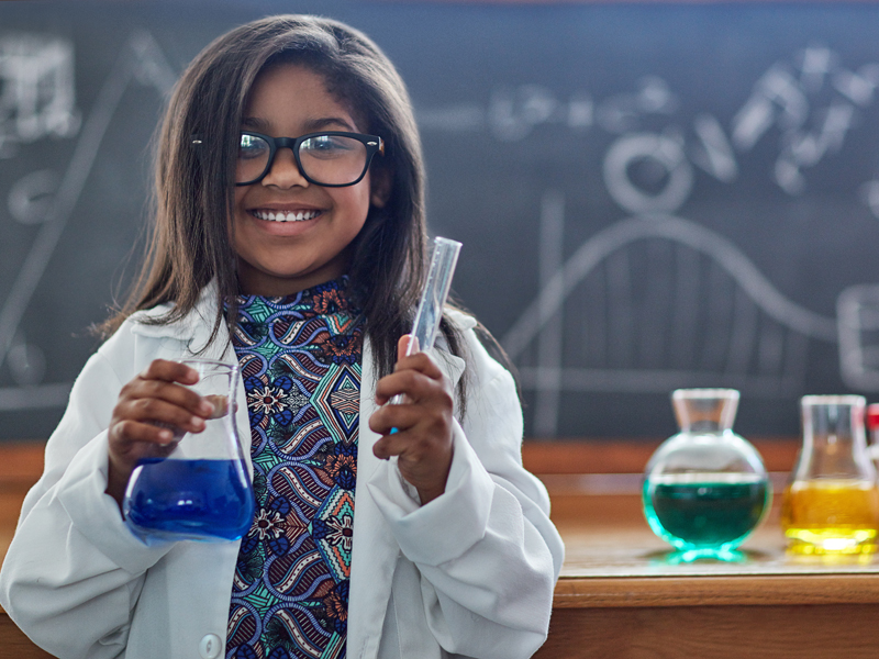 A little girl conducts science experiments
