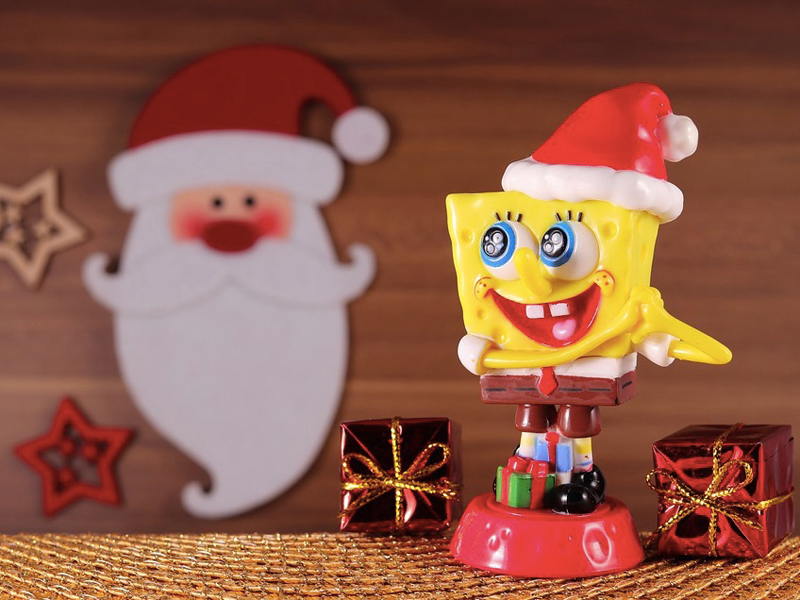 A festive SpongeBob Square Pants with Santa image in the background